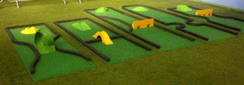 Crazy Golf Course for Hire. A range of crazy golf holes including loop the loop, bridges, tunnels, spirals and more. Perfect putting fun for events indoors or outside